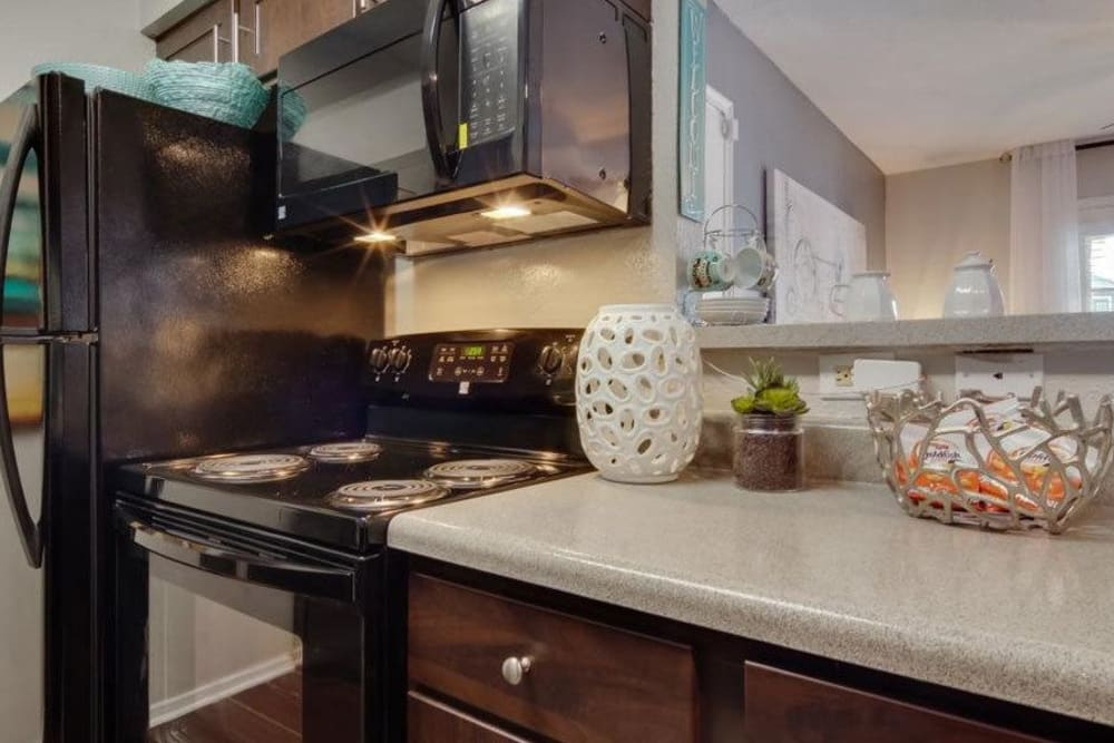 Modern kitchen with beautiful wood cabinets and ample counter space at Vantage Point in Houston, Texas