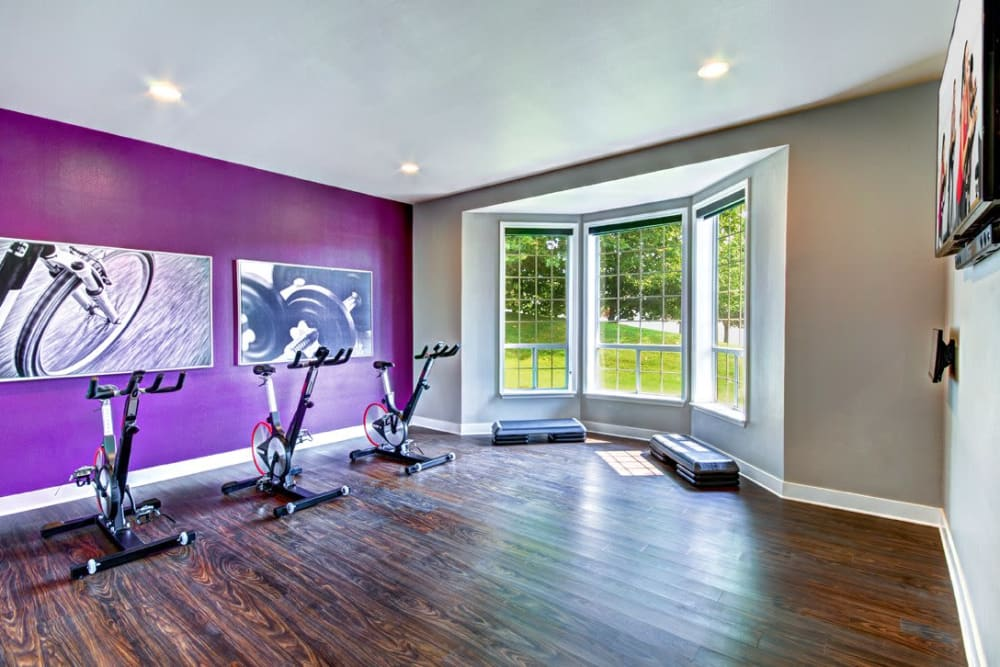 Part of the fitness center with a large window overlooking the property at Wellington Apartment Homes in Silverdale, Washington