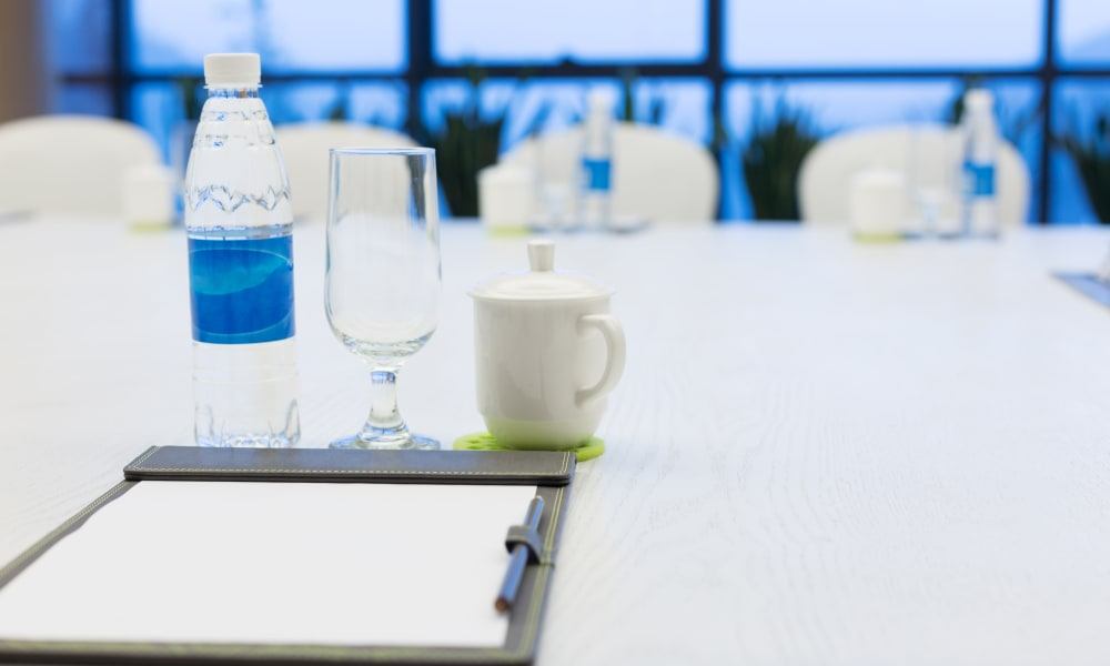 A bottle of water and a cup at The Venue in Rochester, New York