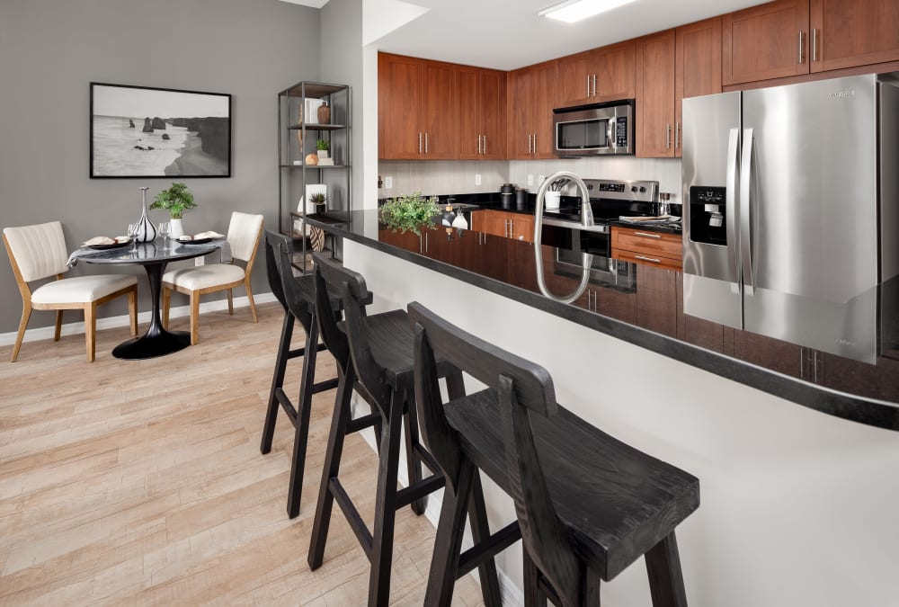 Kitchen with stainless-steel appliances in kitchen of model home at Midtown 24 in Plantation, Florida