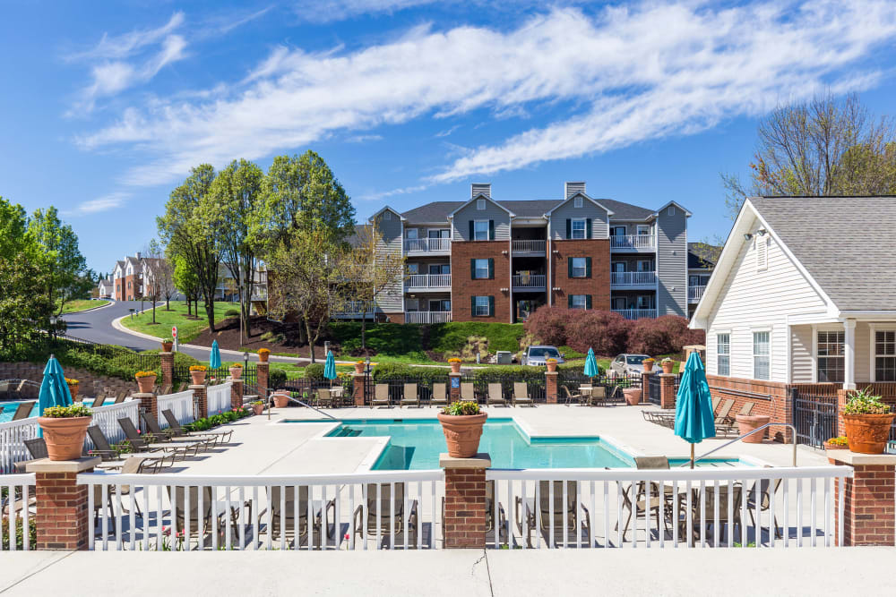 Resort-style swimming pool with a sundeck at Glade Creek Apartments in Roanoke, Virginia