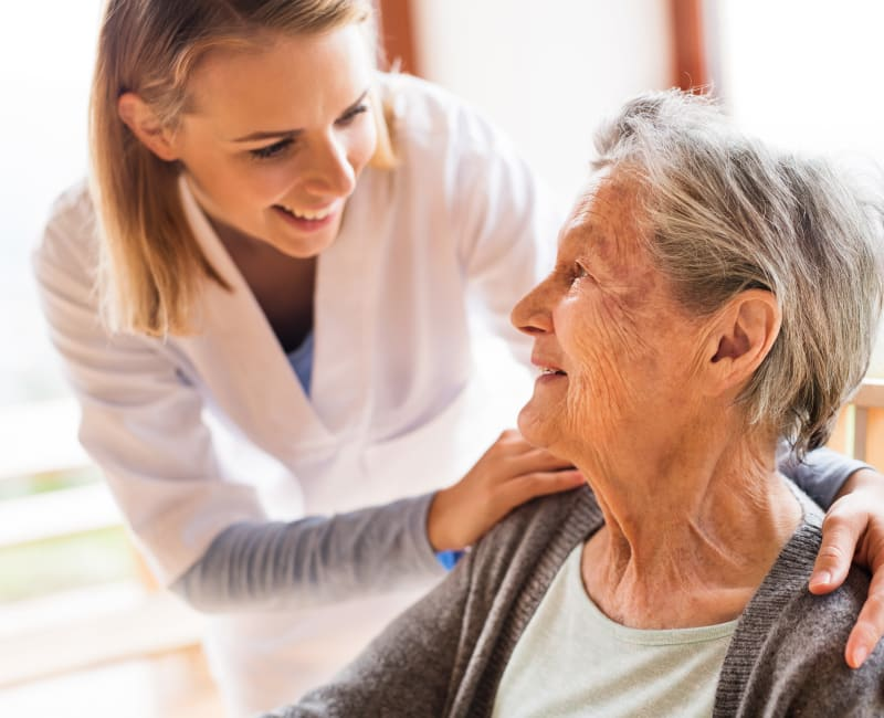 A caregiver helping a resident at The Sanctuary at St. Cloud in St. Cloud, Minnesota