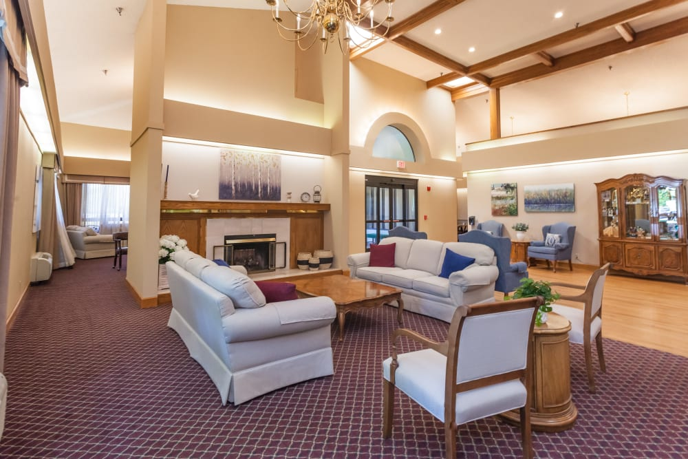 Comfy area with fireplace to sit down and relax at River Commons Senior Living in Redding, California