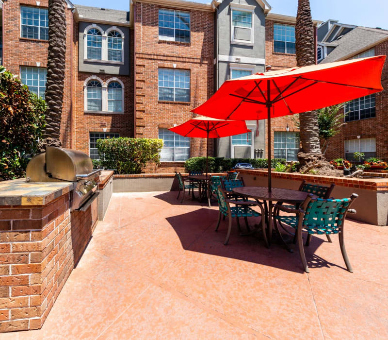 Patio with grills, tables, and chairs at Marquis on Pin Oak in Houston, Texas