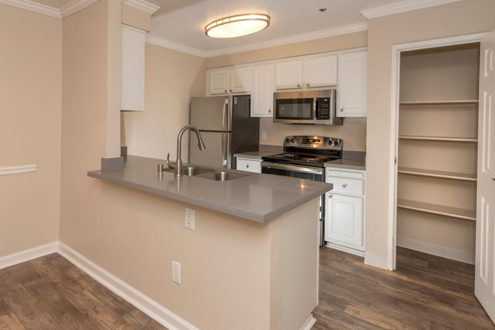 Kitchen featuring bar at Sterling Heights Apartment Homes in Benicia, California