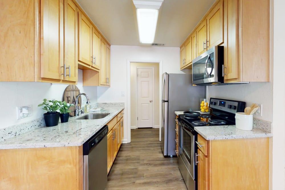 Stainless-steel appliances in a model apartment's kitchen at Pleasanton Glen Apartment Homes in Pleasanton, California