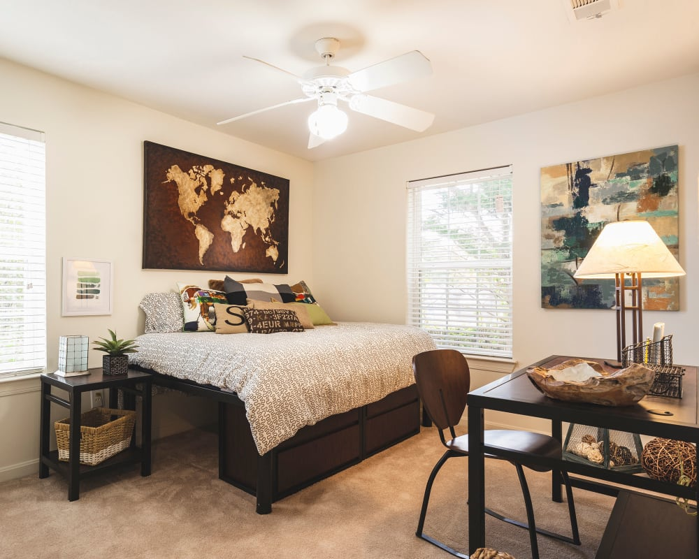 Spacious master bedroom with plush carpeting at Sunchase at James Madison in Harrisonburg, Virginia