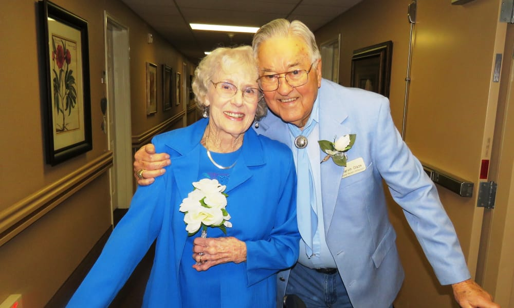 Dressed-up elderly couple posing for a photo at Ashton Gardens Gracious Retirement Living in Portland, Maine