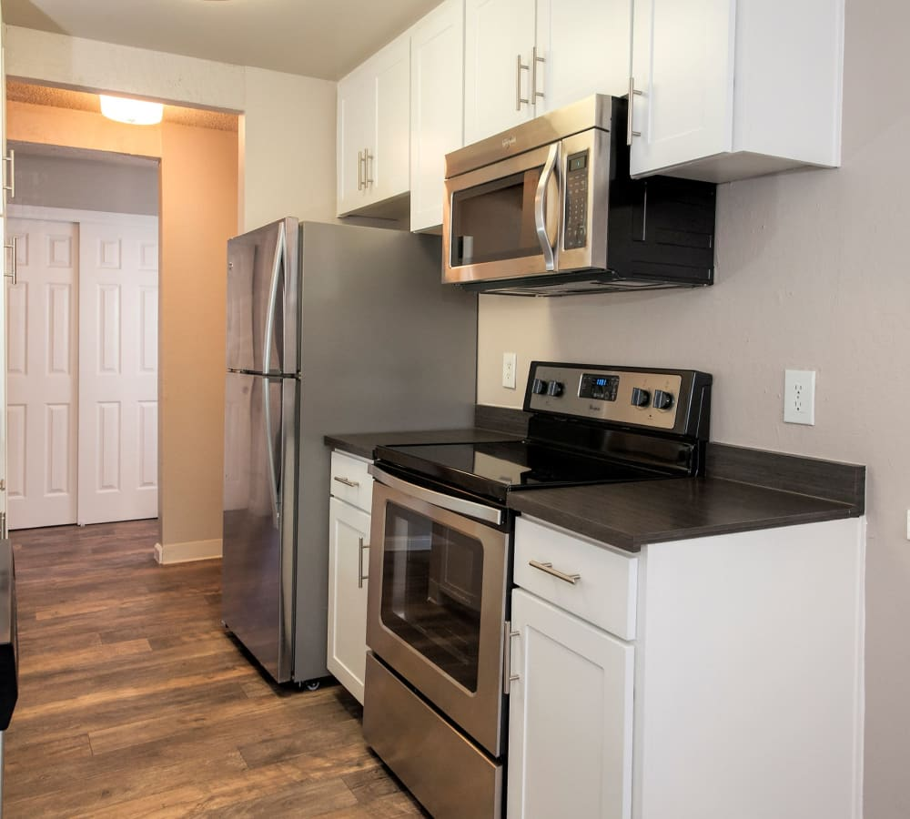 Kitchen with stainless-steel appliances at Shadow Oaks Apartment Homes in Cupertino, California
