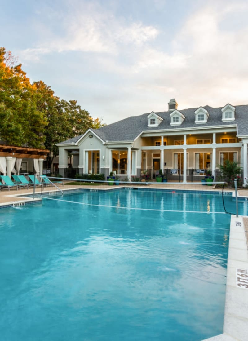 Shallow end of pool with gazebo area and clubhouse in background at Marquis at Stonegate in Fort Worth, Texas
