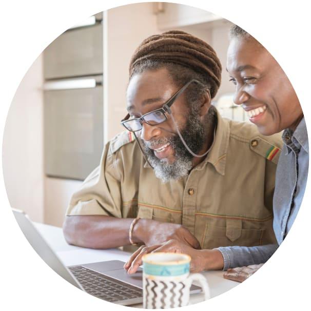 Residents browsing the internet on their laptop at a Ebenezer Senior Living community