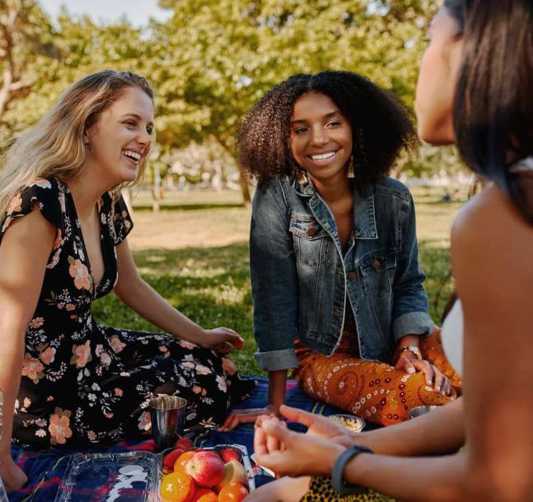 Friends gather for a picnic at Town Center Park, near Strata Apartments in Denver, Colorado