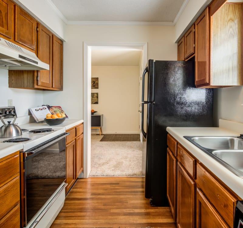 Spacious kitchen at Coach House Apartments in Kansas City, Missouri