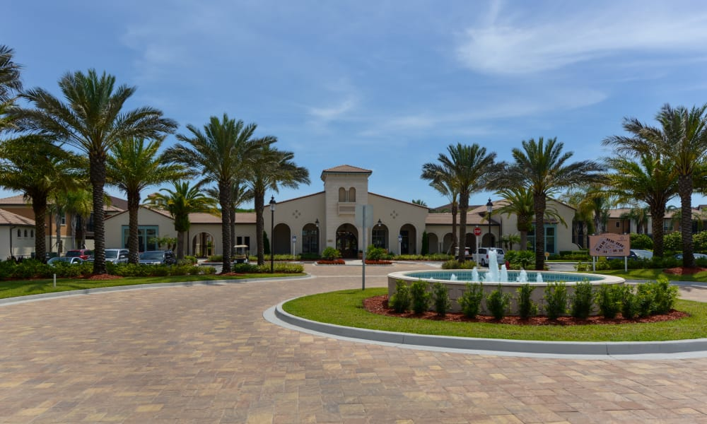 Cobblestone drive with an island and fountain in the middle as you approach the entrance to Hacienda Club in Jacksonville, Florida