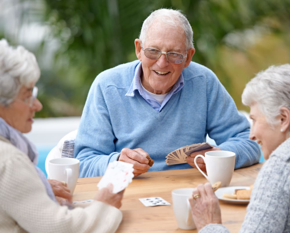 Resident playing card games together at WellQuest of Granite Bay in Granite Bay, California