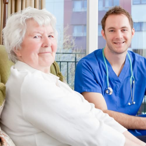 Registered nurse from At Home Care Group in Oregon with a patient.