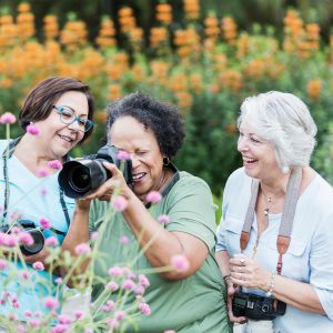 Resident taking a picture of some flowers with a large camera at Hanover Place in Tinley Park, Illinois