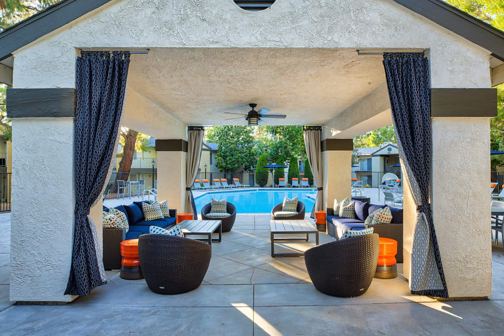 Covered cabana-style lounge area near the swimming pool at Mountain Vista in Victorville, California