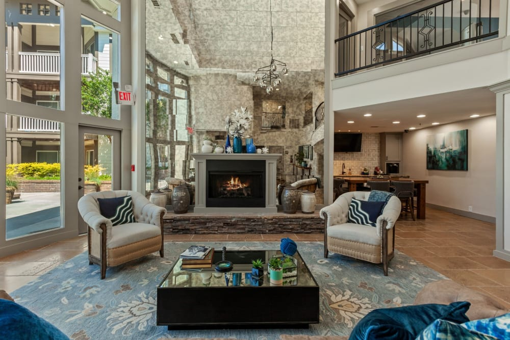 Spacious clubhouse area with a fireplace at 45Eighty Dunwoody Apartment Homes in Dunwoody, Georgia