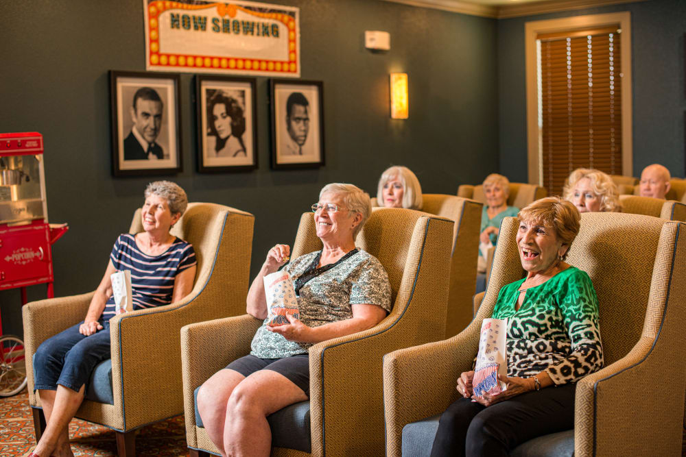 Residents watching a movie at Watermere at Flower Mound in Flower Mound, Texas