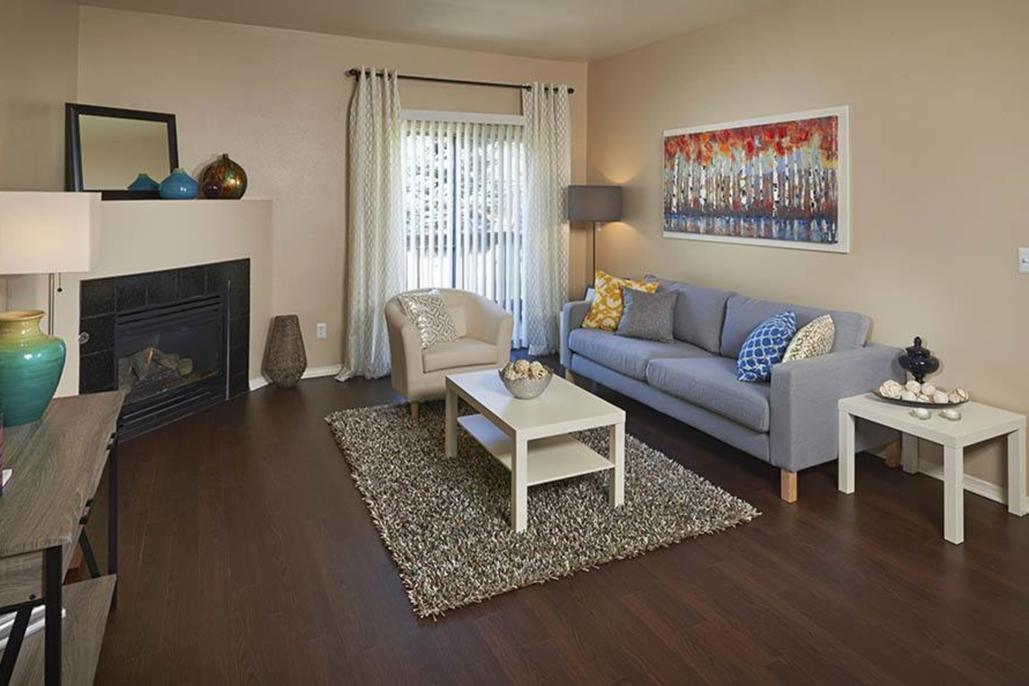 Living room with a fireplace at Crossroads at City Center Apartments in Aurora, Colorado