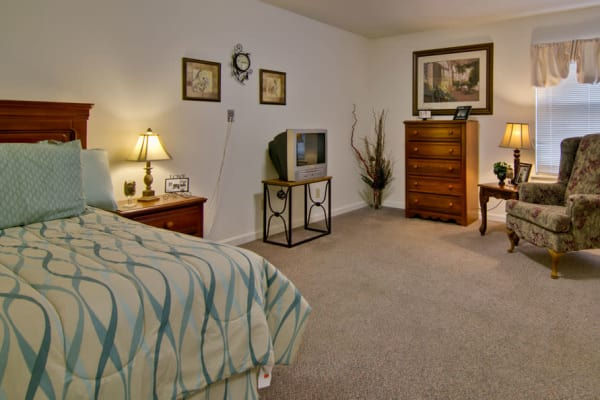 Assisted living apartment bedroom at Parkwood Meadows Senior Living in Sainte Genevieve, Missouri