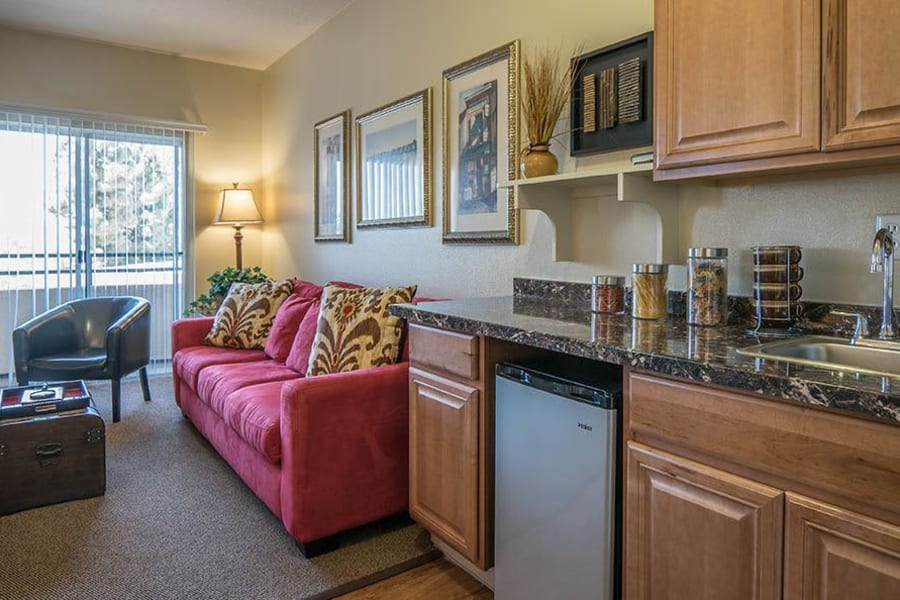 Beautiful kitchen with granite countertops in one of our independent living suites at Carmel Village in Fountain Valley, California