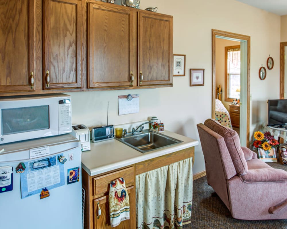 Resident apartment with a kitchenette at SunnyBrook Carroll in Carroll, Iowa.