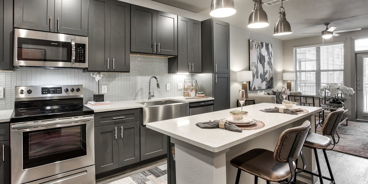 Kitchen with pendant lighting at Two99 Monroe in Roanoke, Texas