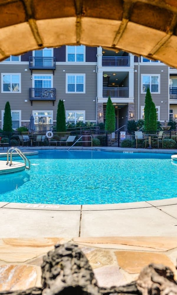 Gorgeous swimming pool and lounge area at Fountains at Mooresville Town Square in Mooresville, North Carolina