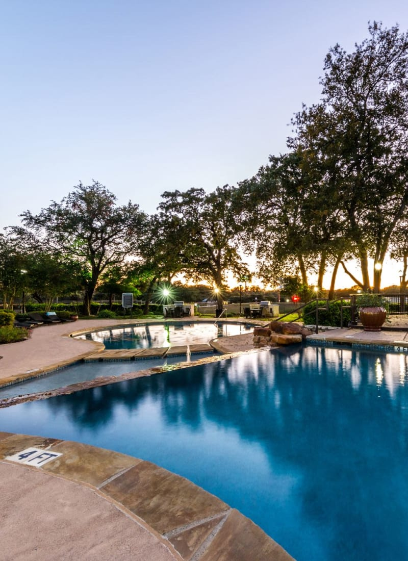 Outdoor swimming pool at sunset at The Marquis at Brushy Creek in Austin, Texas
