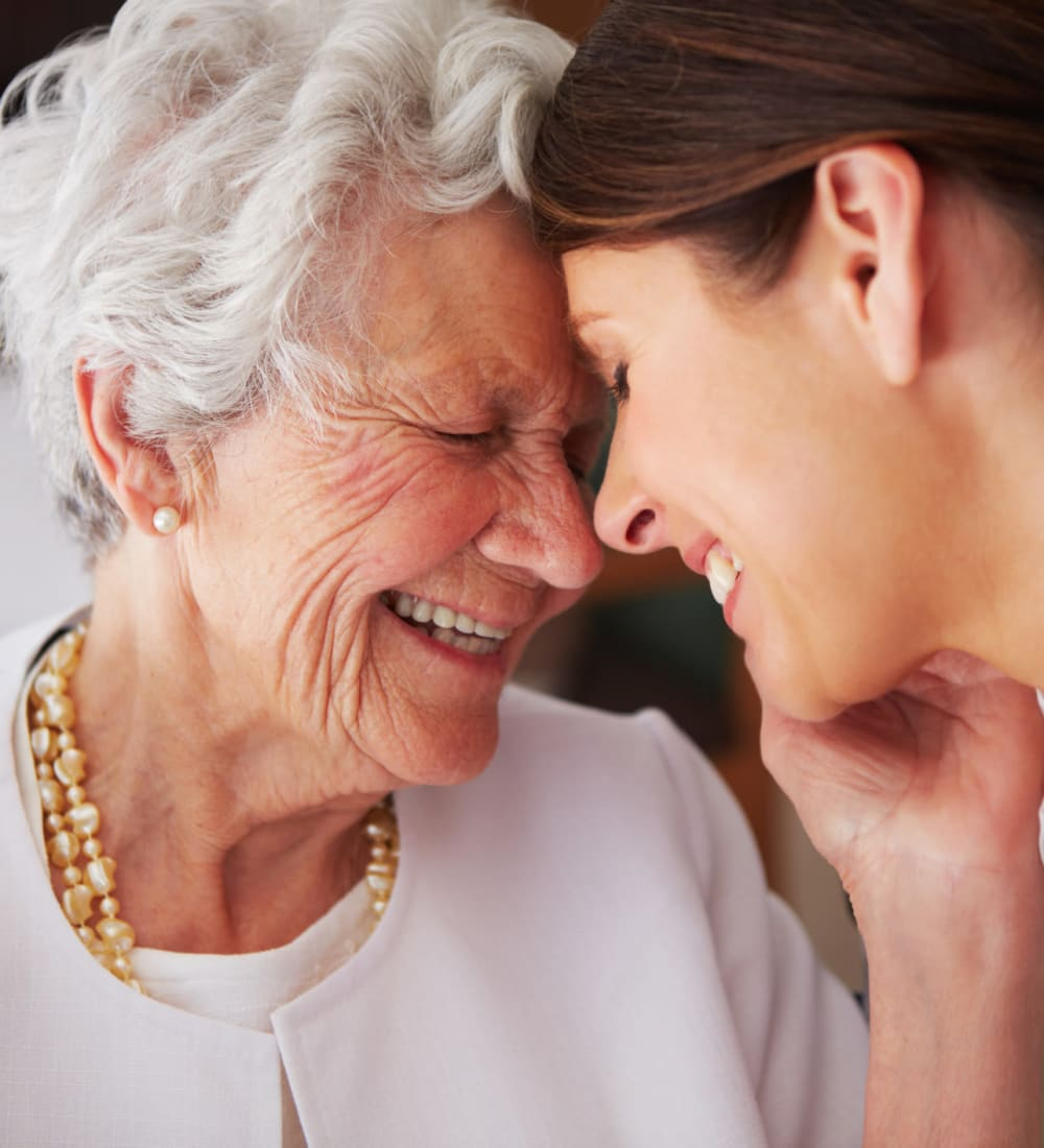 Resident and caretaker sharing a moment at MacArthur Hills in Irving, Texas