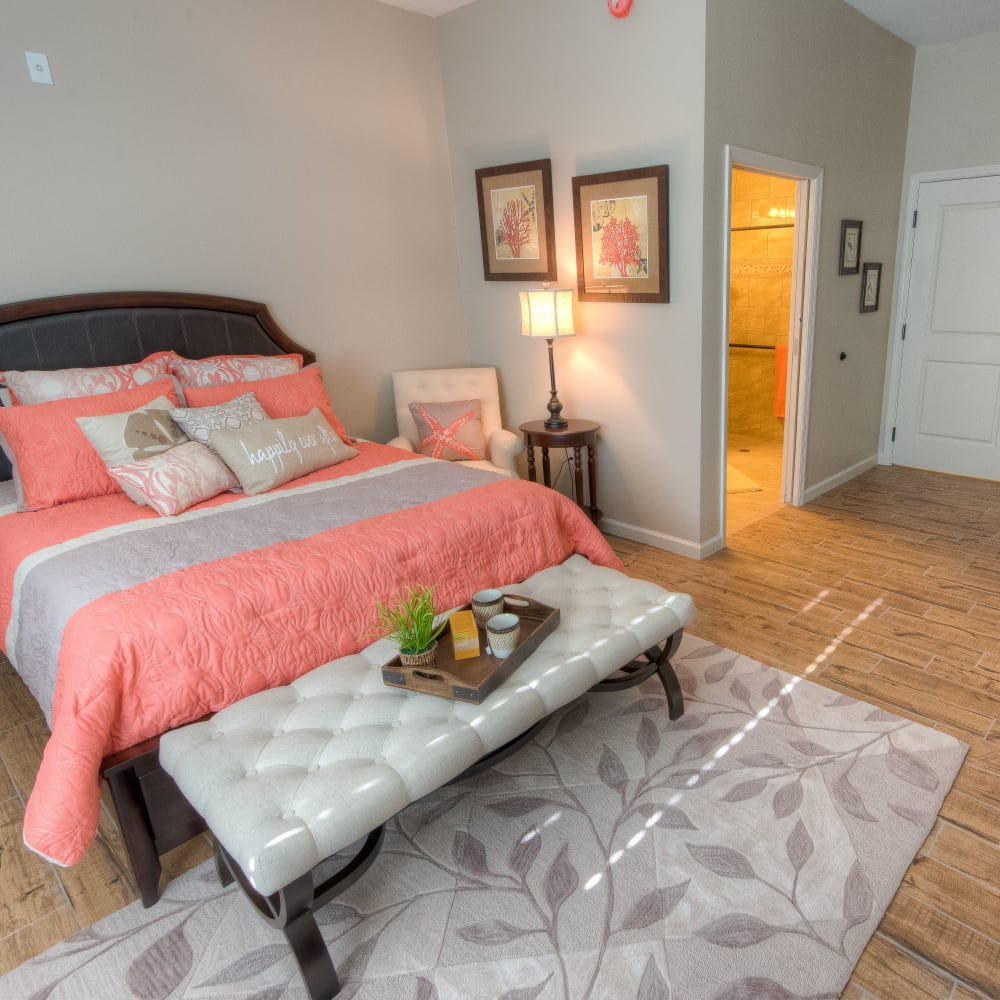 Resident bedroom with private bathroom at Inspired Living in Kenner, Louisiana