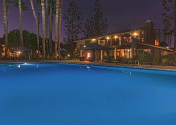 Swimming pool at night at Parcwood Apartments