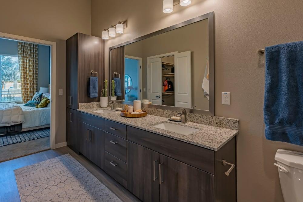 A bathroom with a large vanity at Encore Tessera in Phoenix, Arizona