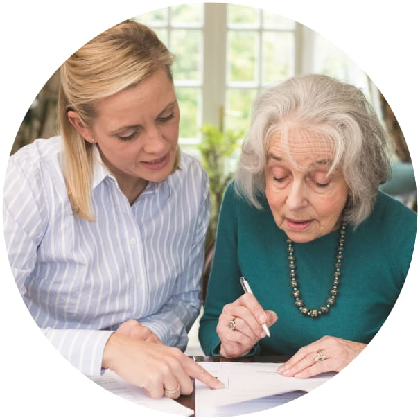 Resident looking at some papers with an advisor at Ebenezer Senior Living