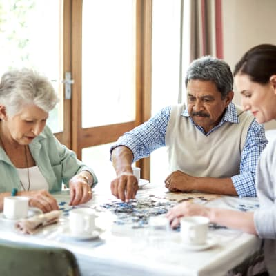A family putting a puzzle together at Chandler's Square Retirement Community in Anacortes, Washington