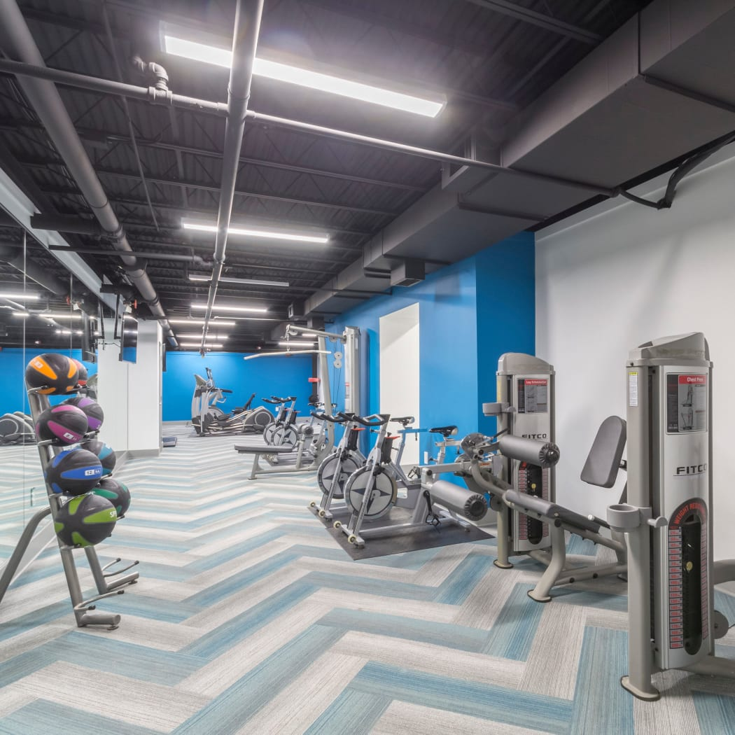Modern fitness center at The Square at Mason Mill Apartments in Decatur, Georgia