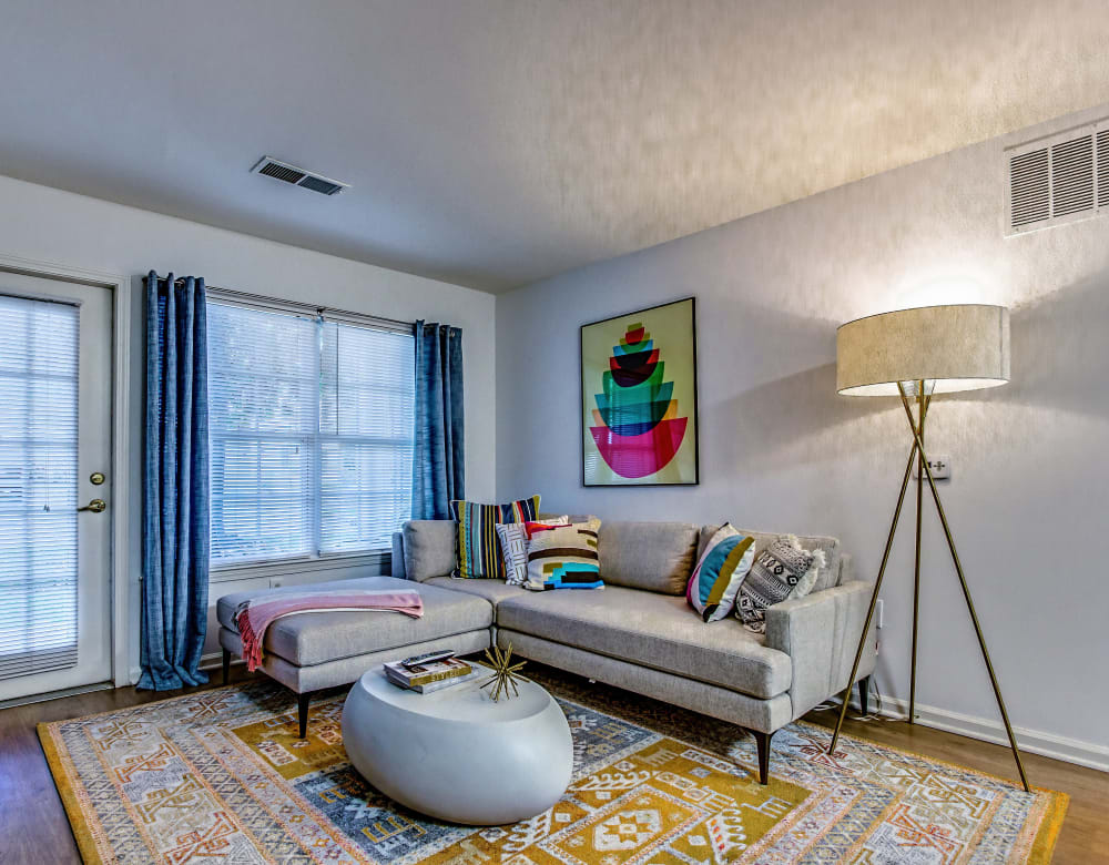 Living room with wood-style flooring at Eagle Rock Apartments at Freehold in Freehold, New Jersey