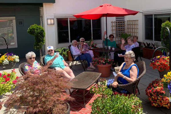 Residents enjoying a patio at Merrill Gardens at Tacoma in Tacoma, Washington.