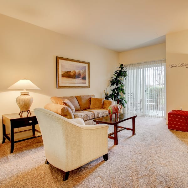 Spacious living room with back patio access at Laguna Creek Apartments in Elk Grove, California