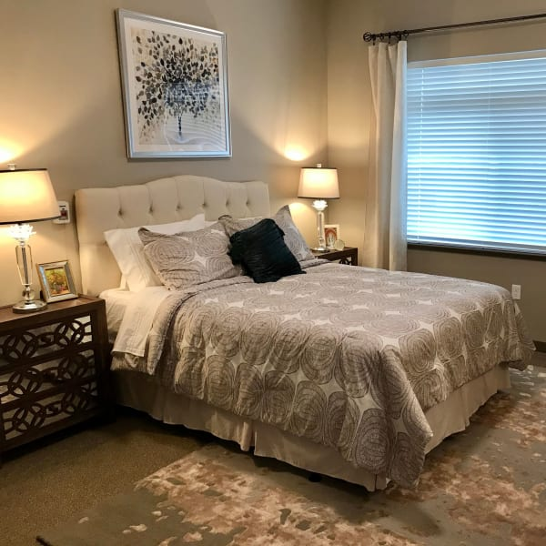 Independent living apartment bedroom at Quail Park at Shannon Ranch in Visalia, California