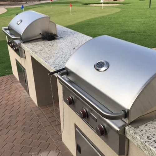 Gas barbecue grills near the putting green at Olympus Northpoint in Albuquerque, New Mexico