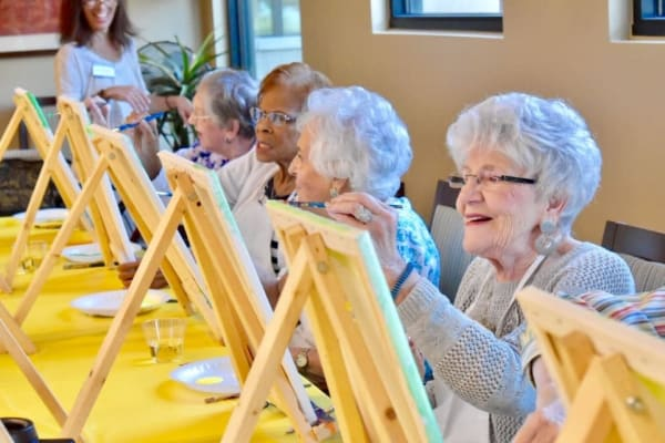 Residents painting at Royal Palm Senior Living in Port Charlotte Florida