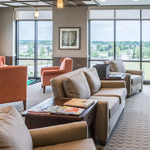 Comfy couches in resident community area at First & Main of Auburn Hills in Auburn Hills, Michigan