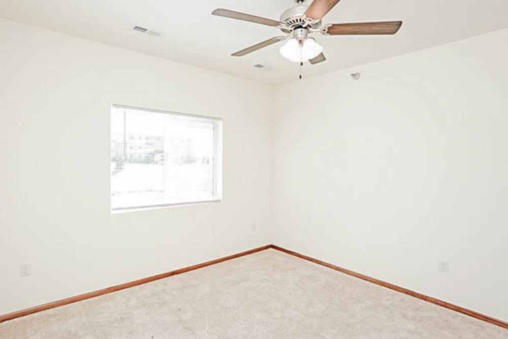 Large room with a ceiling fan at Johnston Heights in Johnston, Iowa