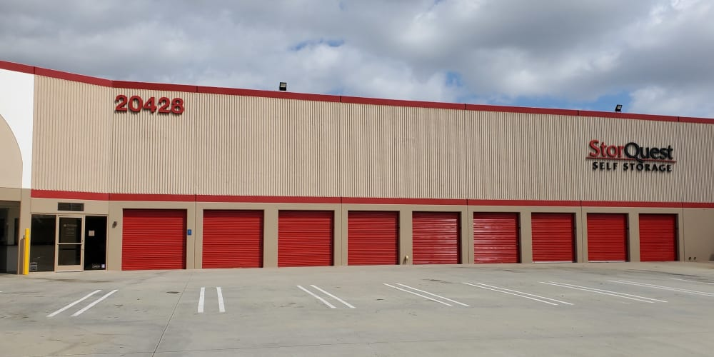 Exterior storage units with red doors at StorQuest Self Storage in Torrance, California