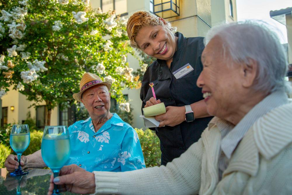 Residents enjoying a meal at senior living in Anthem