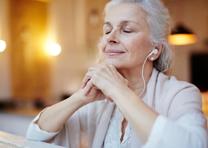 A resident relaxing with headphones at Westminster Memory Care in Lexington, South Carolina