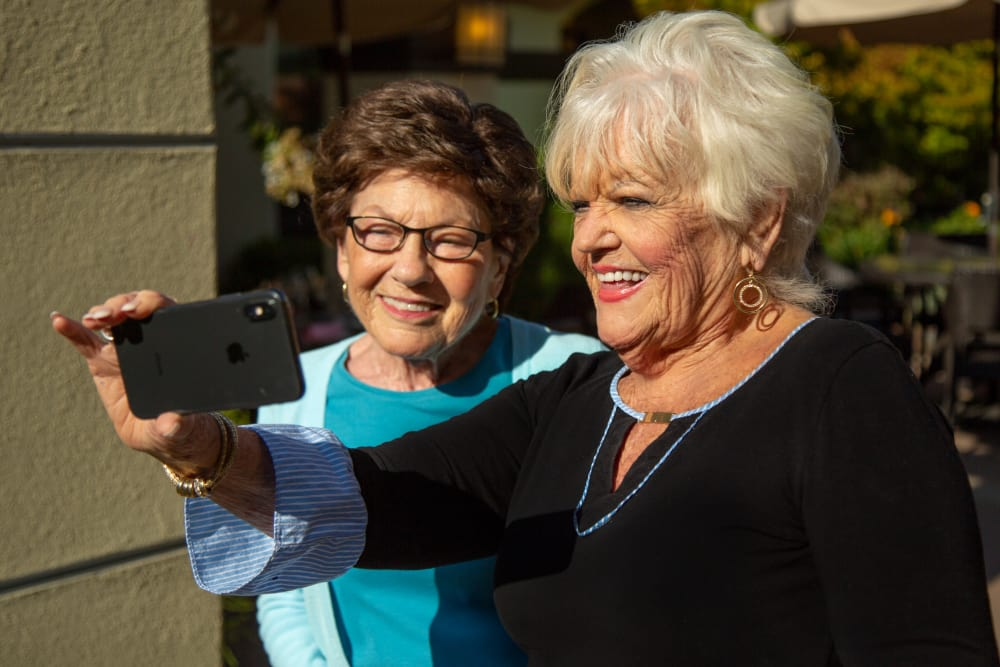 Friends taking a selfie at our senior living community